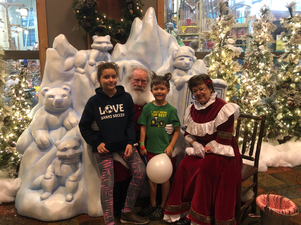 The kids with Santa and Mrs. Claus